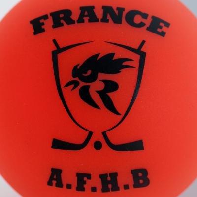 Oranžový hokejbalový míček Oxelo